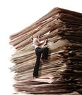 0214_wellness_woman_stack_of_papers_1000x1158